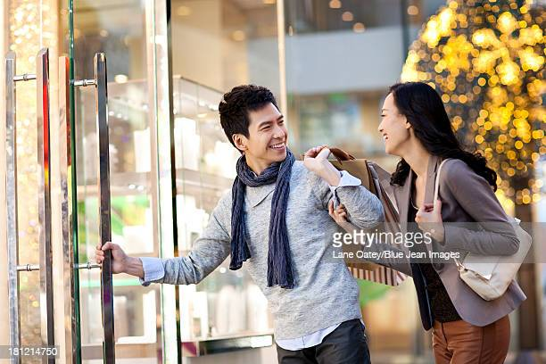 Sweet young couple entering a shopping mall