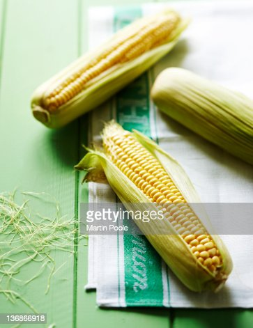 sweetcorn on cloth on table