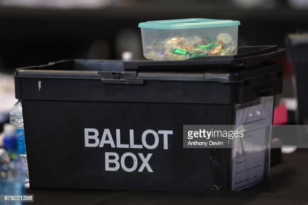 Sweets are placed on top of a ballot box as votes are counted for the Greater Manchester mayoral election at Manchester Central on May 5 2017 in...