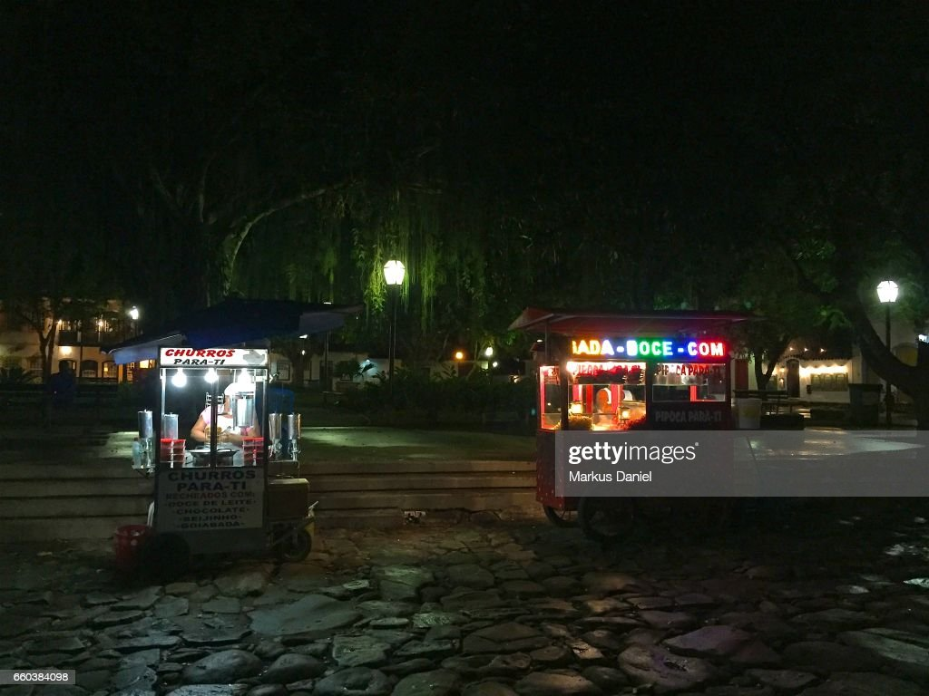 Sweets Vendors at night in the town of Paraty, Rio de Janeiro : Stock Photo