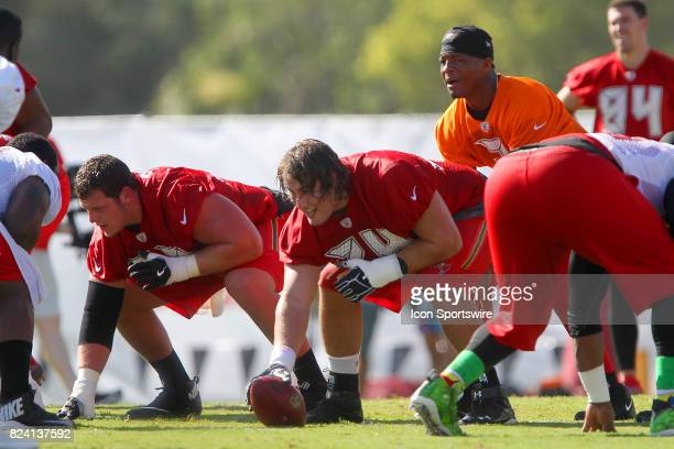 J R Sweezey center Ali Marpet and Jameis Winston line up during the Tampa Bay Buccaneers Training Camp on July 28 2017 at One Buccaneer Place in...