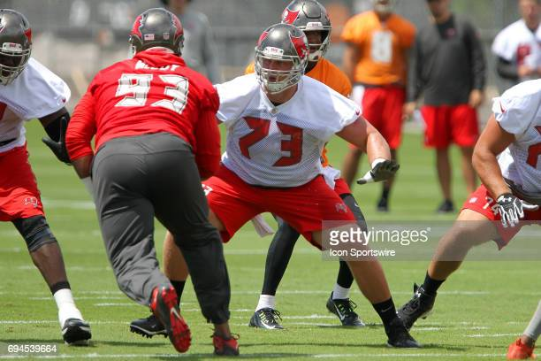 J R Sweezy lines himself up to block on rushing Gerald McCoy during the Tampa Bay Buccaneers OTA on June 08 2017 at One Buccaneer Place in Tampa...