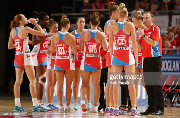 Swifts coach Rob Wright talks to players during the round two Super Netball match between the Sydney Swifts and the Adelaide Thunderbirds at Qudos...