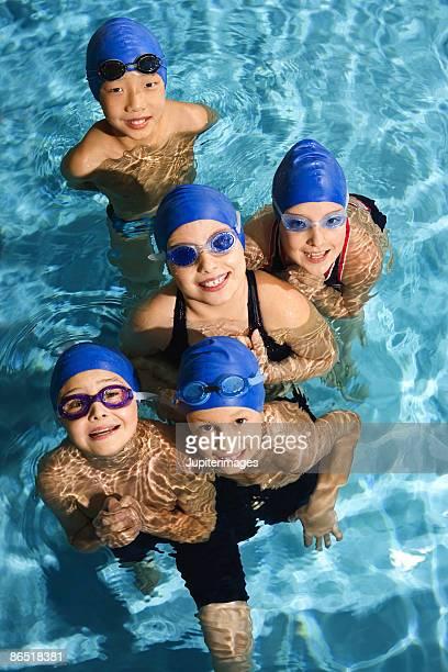 Swim team posing in pool