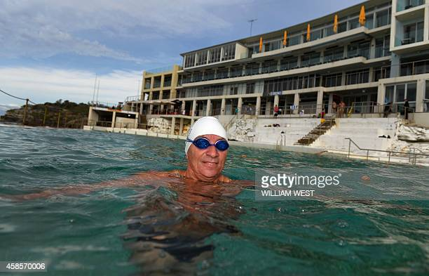 Swimmer Alan Gow relaxes at Bondi's Icebergs one of country's largest and bestknown swimming clubs boasting 1000 members 400500 of whom compete every...