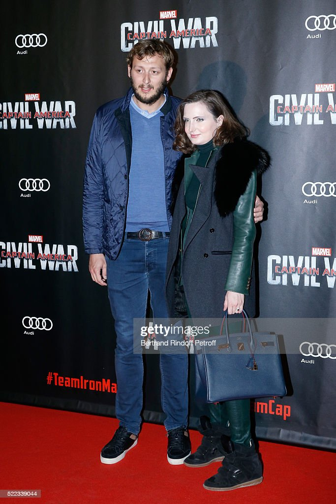 Swimmer Amaury Leveaux and his companion Elizabeth attend the 'Captain America: Civil War' Paris Premiere. Held at Le Grand Rex on April 18, 2016 in Paris, France.