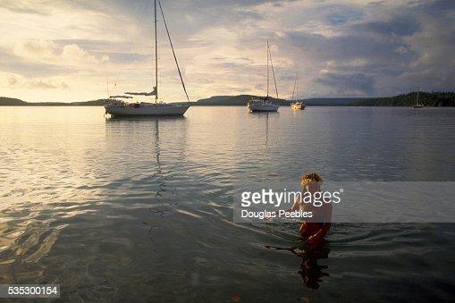 Swimmer and Moored Sailboats at Lisa Beach