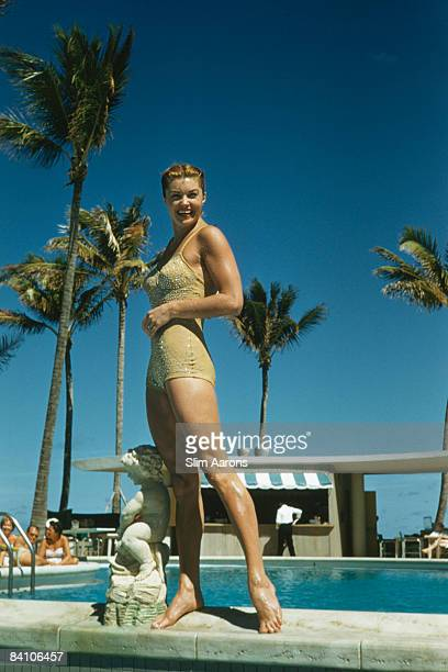 Swimmer and movie star Esther Williams by the pool in Florida 1955