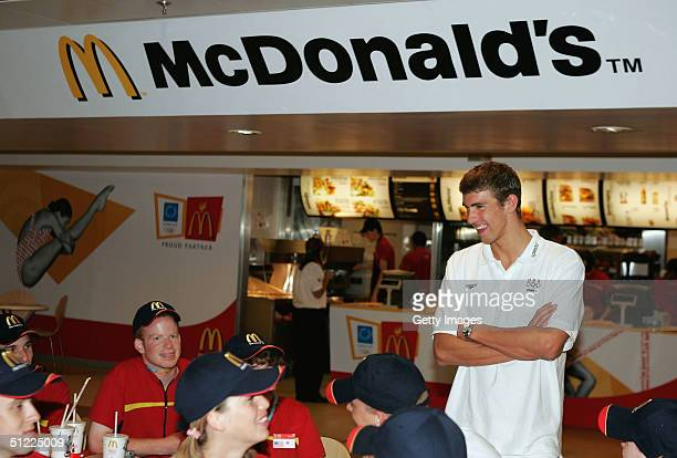 S swimmer and Olympic sensation Michael Phelps surprised McDonald's Olympic Champion Crew with a special visit on August 27 2004 in Athens Greece...