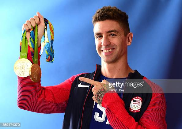 Swimmer Anthony Ervin of the United States poses for a photo with his two gold medals on the Today show set on Copacabana Beach on August 13 2016 in...