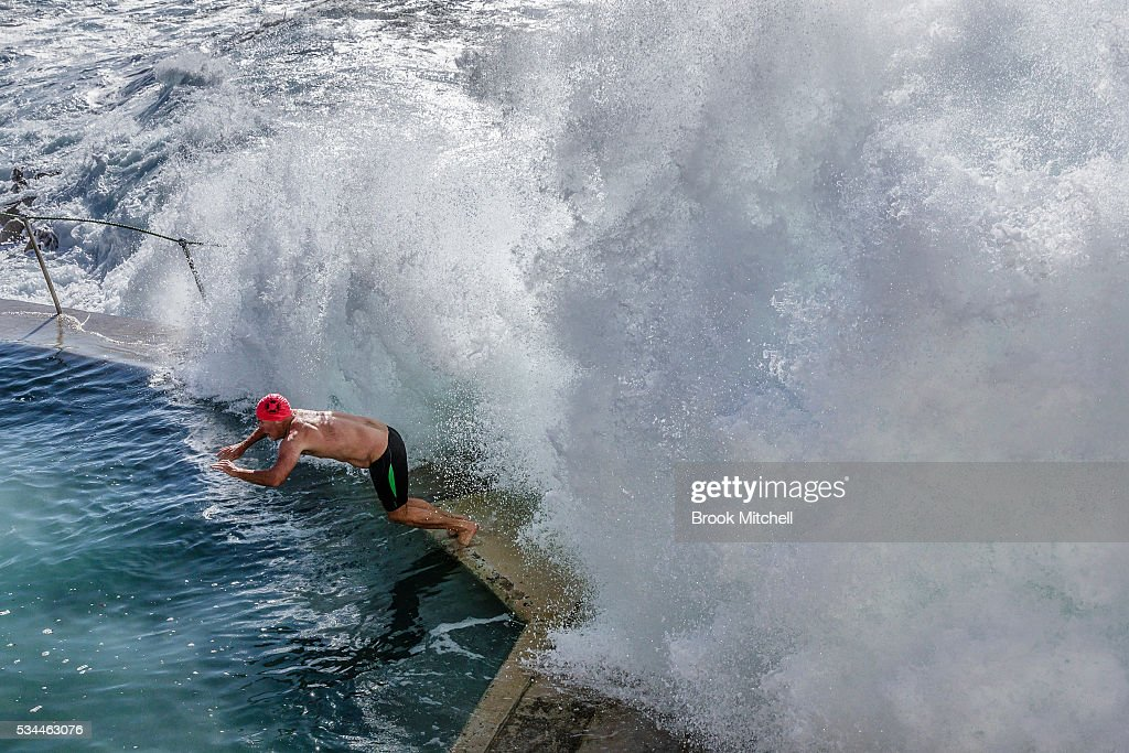A swimmer at Bronte Beach Ocean evades a large wave crashing over the barrier on May 25, 2016 in Sydney, Australia. All Sydney beaches were closed to swimmers today as large waves pounded the coast.