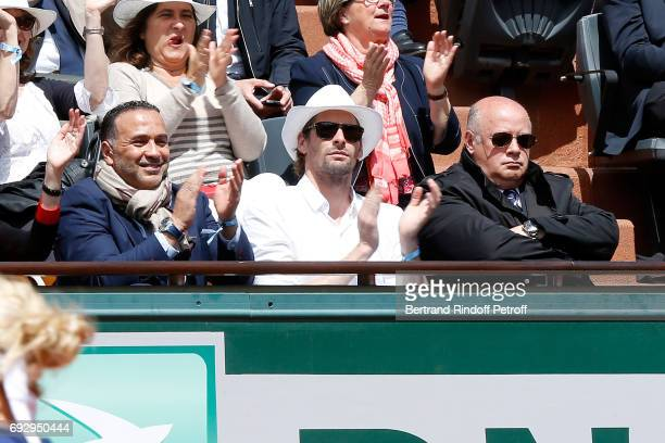 Swimmer Camille Lacourt and President of French Tennis Federation Bernard Giudicelli attend the 2017 French Tennis Open Day Ten at Roland Garros on...