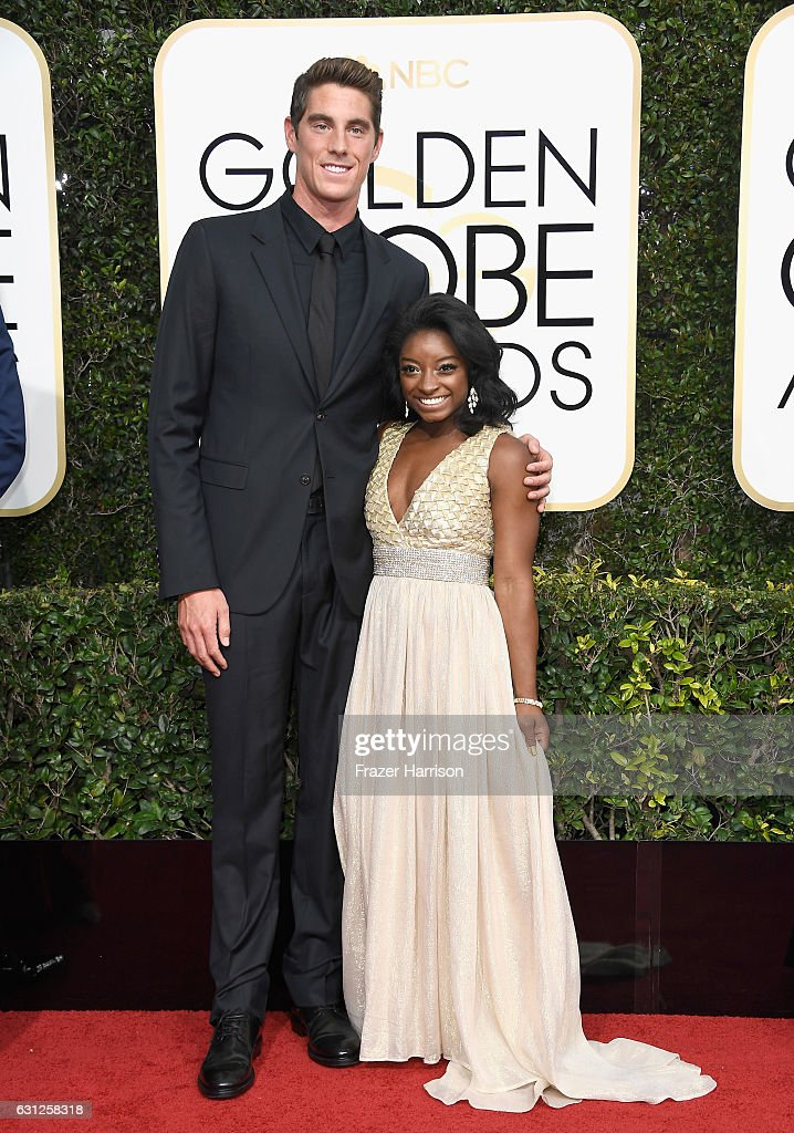 Swimmer Conor Dwyer and gymnast Simone Biles attend the 74th Annual Golden Globe Awards at The Beverly Hilton Hotel on January 8, 2017 in Beverly Hills, California.