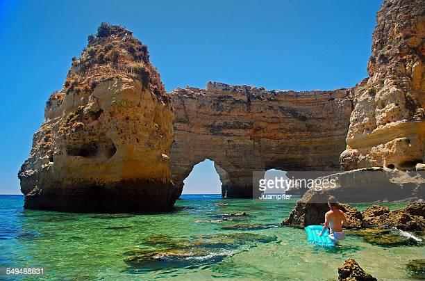 Swimmer discovering Marinha beach