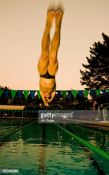 A swimmer dives in the Mill Valley swimmingpool
