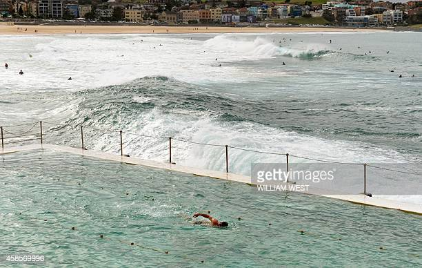 A swimmer does laps at Bondi's Icebergs one of country's largest and bestknown swimming clubs boasting 1000 members 400500 of whom compete every...