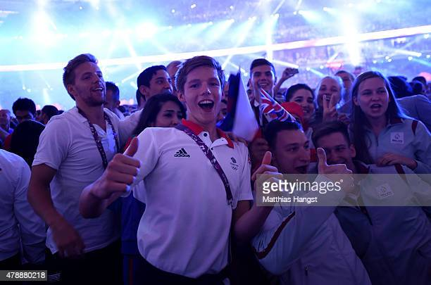 Swimmer Duncan Scott of Great Britai celebrates with teammates during the Closing Ceremony for the Baku 2015 European Games at Olympic Stadium on...