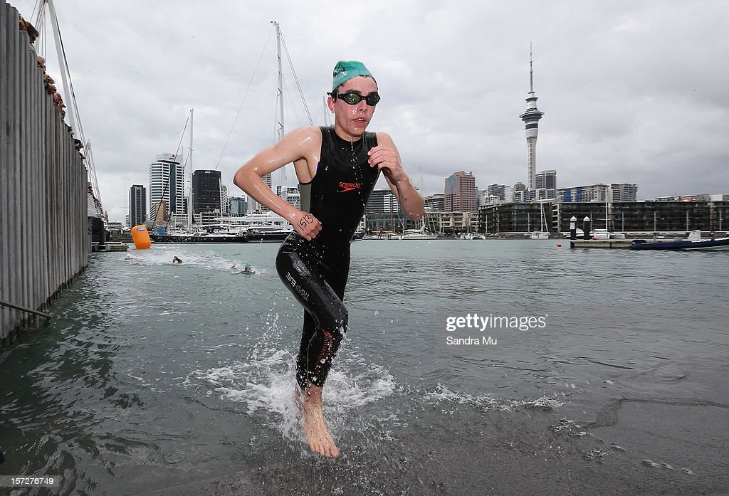 A swimmer emerges from the water during the Auckland Harbour Crossing ocean swim event at the Viaduct Harbour on December 2, 2012 in Auckland, New Zealand.