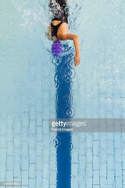 Swimmer following pool lane