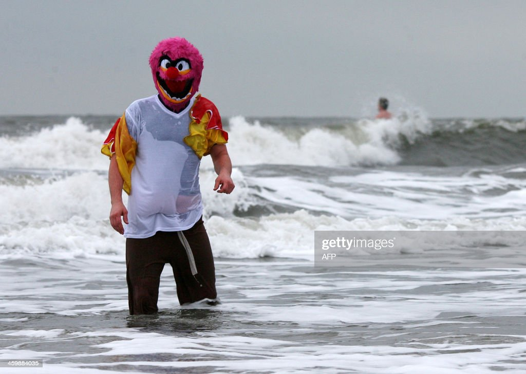 A swimmer in fancy dress braves the cold in the North Sea at the annual New Year's Day sea swim in Whitley Bay, northeast England on January 1, 2014.