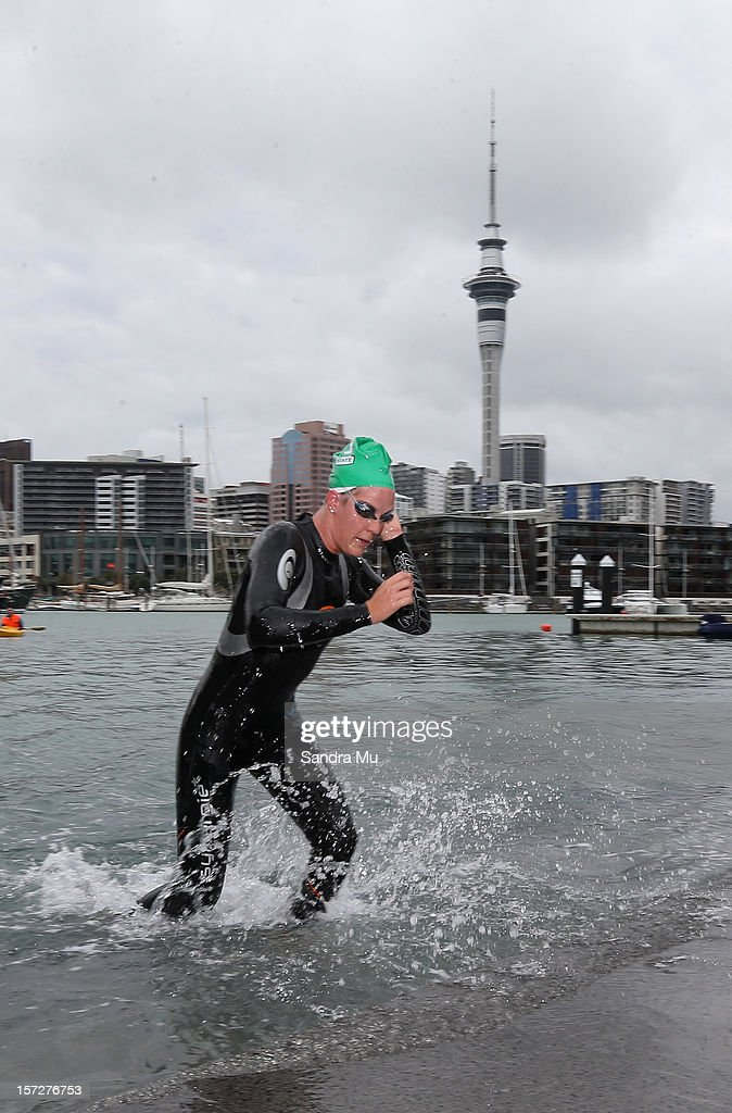 Swimmer Kara Baker emerges from the water during the Auckland Harbour Crossing ocean swim event at the Viaduct Harbour on December 2, 2012 in Auckland, New Zealand.