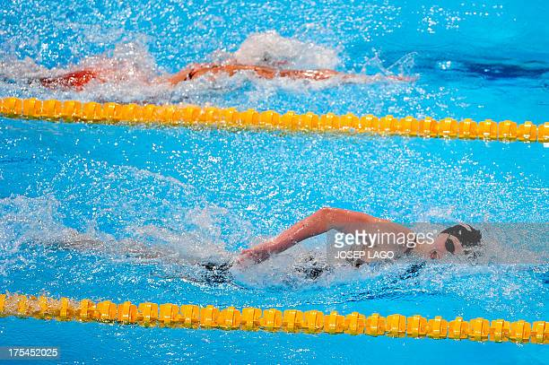US swimmer Katie Ledecky and Denmark's Lotte Friis compete in the final of the women's 800metre freestyle swimming event in the FINA World...