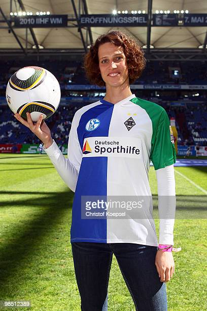 Swimmer Lena Schoeneborn poses in the Veltins Arena and presents the action athletes support athletes before the Bundesliga match between FC Schalke...