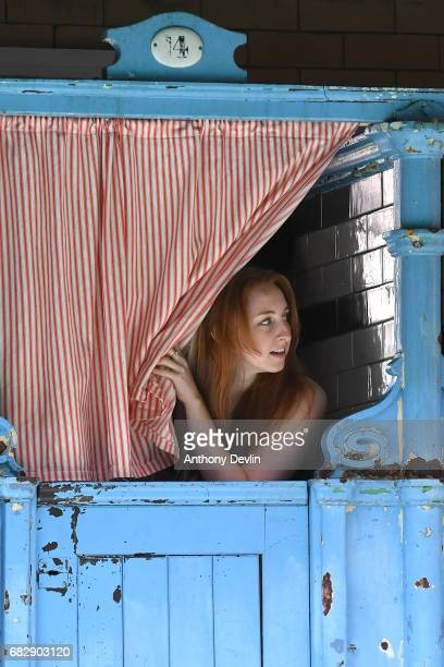 Swimmer Linzi Wright looks out of a changing cubicle as the Men's First Class pool at Victoria Baths are open today for the first time in 20 years...