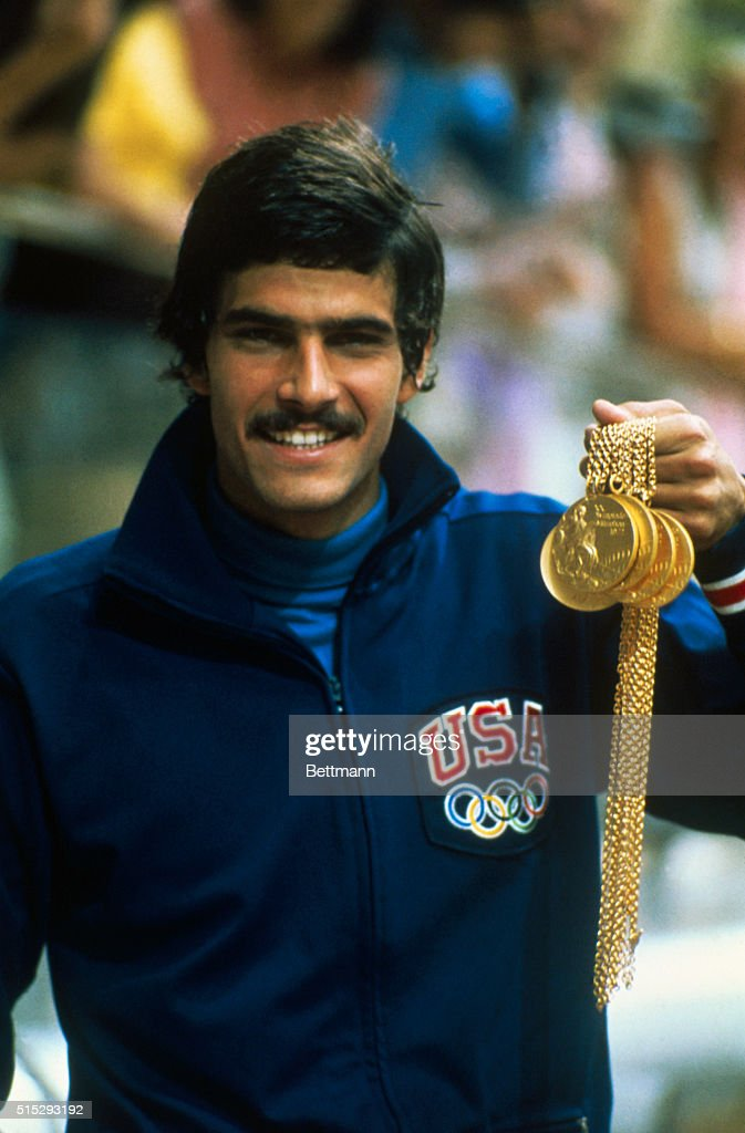 U.S. swimmer Mark Spitz proudly displays the five gold medals he won in the 1972 Summer Olympics.