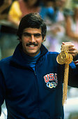 US swimmer Mark Spitz proudly displays the five gold medals he won in the 1972 Summer Olympics