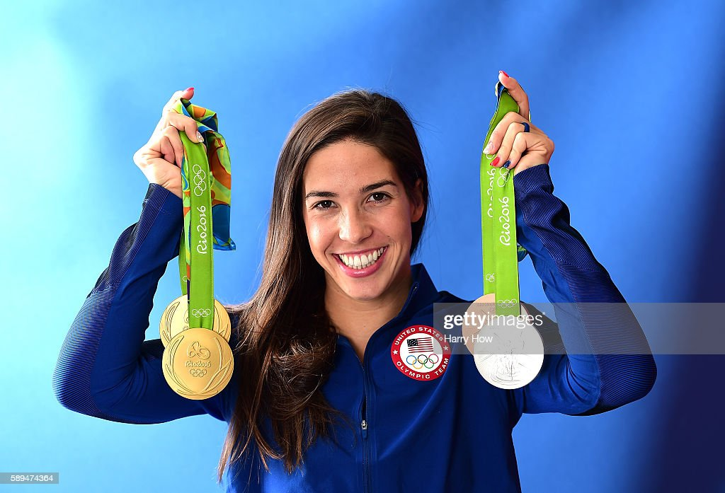 Swimmer, Maya DiRado of the United States poses for a photo with her four medals on the Today show set on Copacabana Beach on August 13, 2016 in Rio de Janeiro, Brazil.