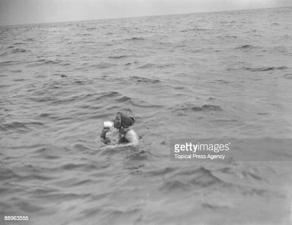 Swimmer Mercedes Gleitze has a drink during her unsuccessful attempt to swim the English Channel 21st October 1927 She abandoned her attempt 8 miles...