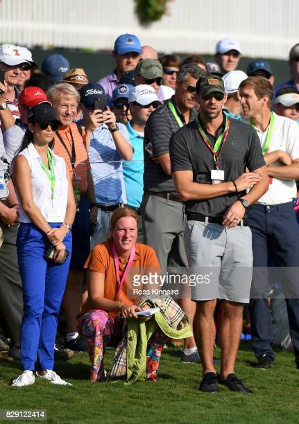 Swimmer Michael Phelps and his wife Nicole Johnson look on during the first round of the 2017 PGA Championship at Quail Hollow Club on August 10 2017...