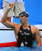 US swimmer Michael Phelps claims victory after the men's 200m freestyle swimming final at the National Aquatics Center in the 2008 Beijing Olympic...