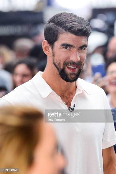 Swimmer Michael Phelps leaves the 'Good Morning America' taping at the ABC Times Square Studios on July 20 2017 in New York City