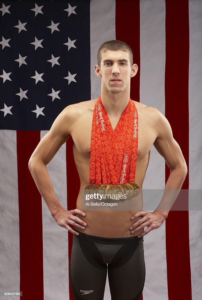 Swimmer <a gi-track='captionPersonalityLinkClicked' href=/galleries/search?phrase=Michael+Phelps&family=editorial&specificpeople=162698 ng-click='$event.stopPropagation()'>Michael Phelps</a> of the United States poses with his eight gold medals all won in competition during the Beijing 2008 Olympic Games on August 18, 2008 in Beijing, China.