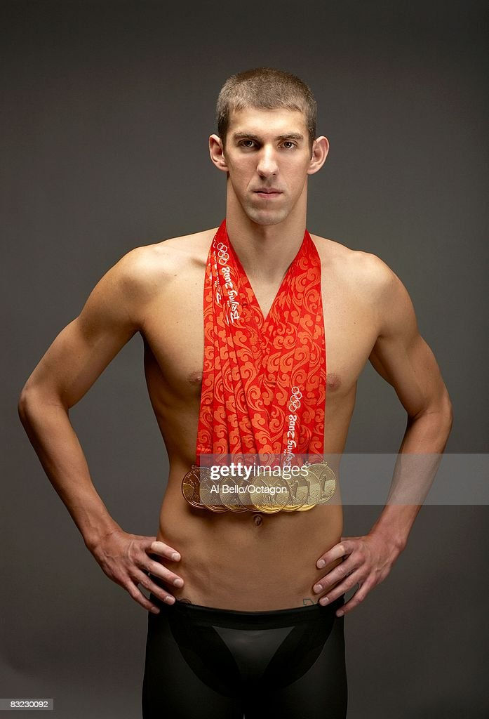 Swimmer Michael Phelps of the United States poses with his eight gold medals all won in competition during the Beijing 2008 Olympic Games on August 18, 2008 in Beijing, China.