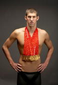 Swimmer Michael Phelps of the United States poses with his eight gold medals all won in competition during the Beijing 2008 Olympic Games on August...