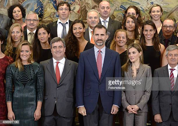 Swimmer Mireia Belmonte King Felipe VI of Spain and Queen Letizia of Spain pose for a group picture with waterpolo and swimming pool teams members...