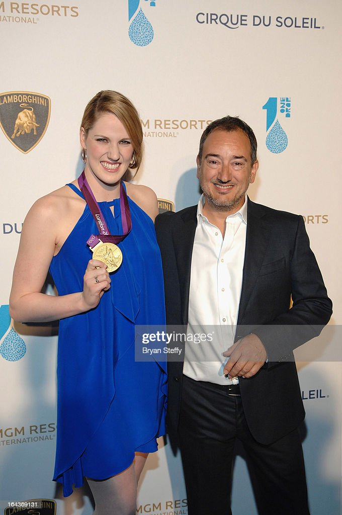 Swimmer <a gi-track='captionPersonalityLinkClicked' href=/galleries/search?phrase=Missy+Franklin&family=editorial&specificpeople=6623958 ng-click='$event.stopPropagation()'>Missy Franklin</a> (L) and Chief Executive Officer of Automobili Lamborghini America Michael Lock arrive at Cirque du Soleil's 'One Night for ONE DROP' at Hyde Bellagio at the Bellagio on March 22, 2013 in Las Vegas, Nevada.