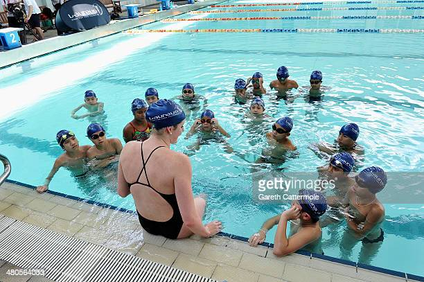 Swimmer Missy Franklin and Laureus World Sportswoman of the Year nominee gives a swimming lesson to local children during the Laureus Familiarization...