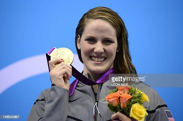 US swimmer Missy Franklin poses on the podium with the gold medal after winning the women's 100m backstroke swimming event at the London 2012 Olympic...