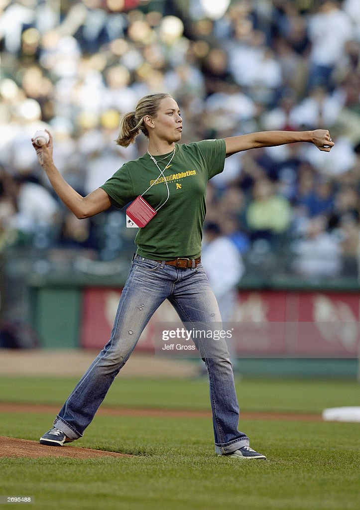 Swimmer Natalie Coughlin throws the first pitch before the Boston Red Sox take on the Oakland A's in Game 5 of the 2003 American League Divisional Series on October 6, 2003 at Network Associates Coliseum in Oakland, California. The Red Sox defeated the A's 4-3.