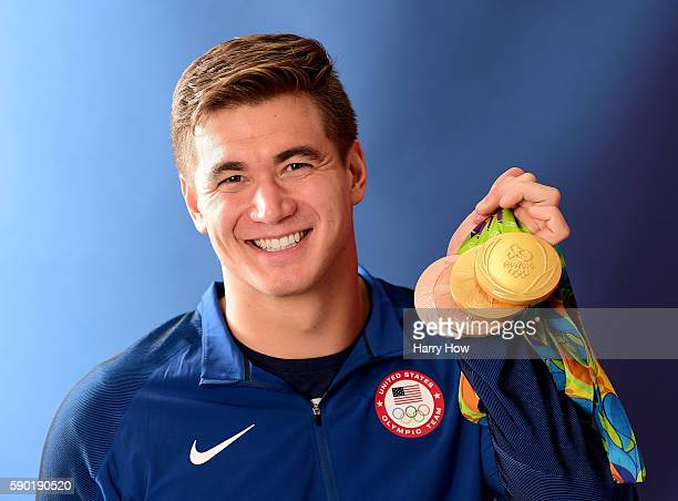 Swimmer Nathan Adrian of the United States poses for a photo with his four medals on the Today show set on Copacabana Beach on August 15 2016 in Rio...