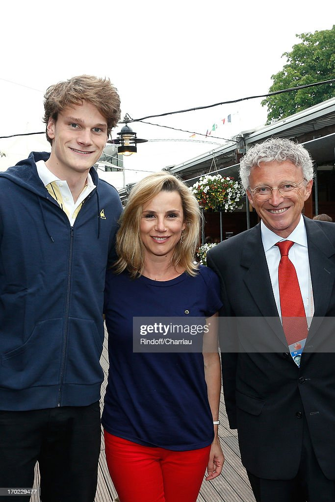 Swimmer Olympic Champion <a gi-track='captionPersonalityLinkClicked' href=/galleries/search?phrase=Yannick+Agnel&family=editorial&specificpeople=6567514 ng-click='$event.stopPropagation()'>Yannick Agnel</a> with journalists <a gi-track='captionPersonalityLinkClicked' href=/galleries/search?phrase=Laurence+Ferrari&family=editorial&specificpeople=777181 ng-click='$event.stopPropagation()'>Laurence Ferrari</a> and Nelson Monfort sighting at the Roland Garros Tennis French Open 2013 - Day 15 on June 9, 2013 in Paris, France.