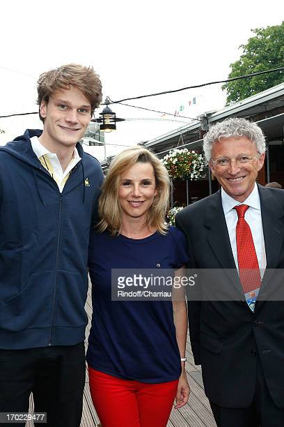 Swimmer Olympic Champion Yannick Agnel with journalists Laurence Ferrari and Nelson Monfort sighting at the Roland Garros Tennis French Open 2013 Day...