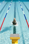 Swimmer on pool start block