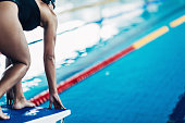 Swimmer on starting block