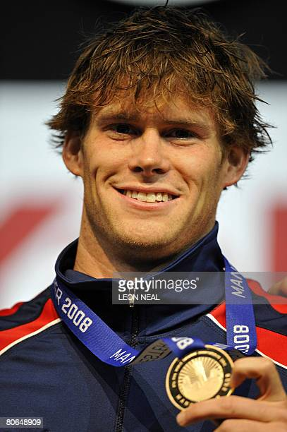 US swimmer Peter Marshall celebrates with a gold medal after winning the Final of the Mens 50m Backstroke during the fourth day of the ninth FINA...