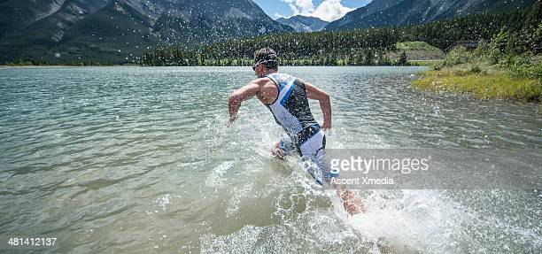 Swimmer plunging into mountain lake
